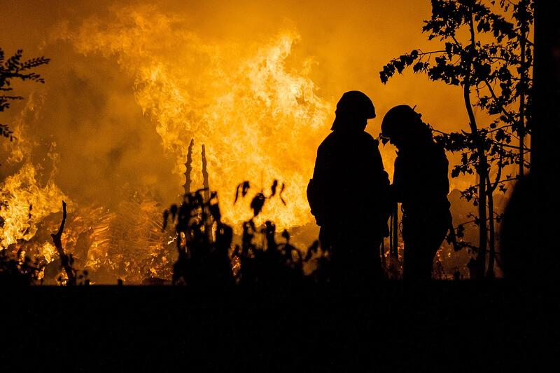 Firefighters battle blazes during record wildfire year.