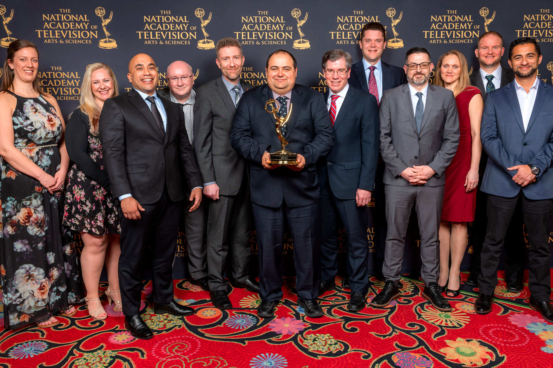 Dejero founder Bogdan Frusina and the Dejero team accepting the company's first Emmy® at the 70th annual Technology and Engineering Awards in 2019