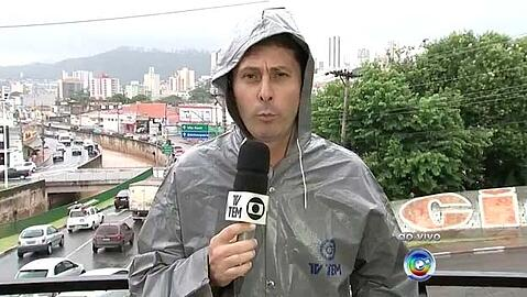 TV TEM journalist with a raincoat going live with Dejero